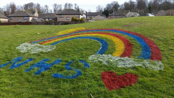 Picture of a rainbow painted on grass for the NHS