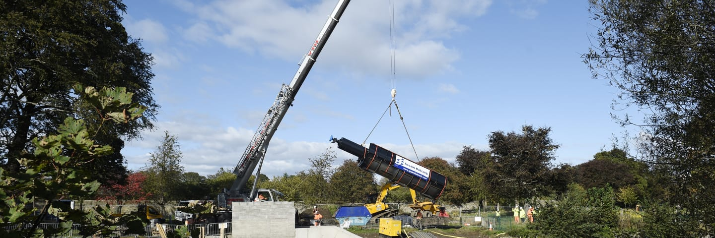Archimedes screw hoisted into pride of place at Saughton Park micro-hydro scheme